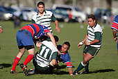 P. Talosaga is taken to ground by S. Petelo & A. Te Pou.  Counties Manukau Premier Club Rugby, Ardmore Marist vs Manurewa played at Bruce Pulman Park, Papakura on the 10th of June 2006. Ardmore Maris won 18 - 11.