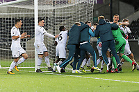 Pictured: Swansea players celebrate after the penalty shoot out. Tuesday 01 May 2018<br /> Re: Swansea U19 v Cardiff U19 FAW Youth Cup Final at the Liberty Stadium, Swansea, Wales, UK