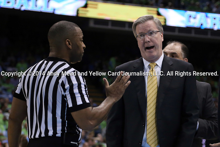 03 December 2014: Iowa head coach Fran McCaffery (right) disagrees with referee Michael Roberts (left). The University of North Carolina Tar Heels played the University of Iowa Hawkeyes in an NCAA Division I Men's basketball game at the Dean E. Smith Center in Chapel Hill, North Carolina. Iowa won the game 60-55.