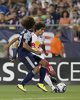 New York Red Bulls midfielder Mehdi Ballouchy (10) crosses the ball. In a Major League Soccer (MLS) match, the New England Revolution tied New York Red Bulls, 2-2, at Gillette Stadium on August 20, 2011.