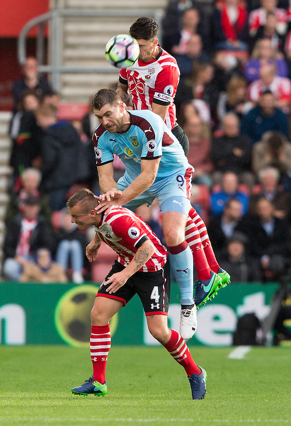 Southampton's Jose Fonte rises above Burnley's Sam Vokes and teammate Jordy Clasie<br /> <br /> Photographer James Williamson/CameraSport<br /> <br /> The Premier League - Southampton v Burnley - Sunday 16th October 2016 - St Mary's Stadium - Southampton<br /> <br /> World Copyright &copy; 2016 CameraSport. All rights reserved. 43 Linden Ave. Countesthorpe. Leicester. England. LE8 5PG - Tel: +44 (0) 116 277 4147 - admin@camerasport.com - www.camerasport.com