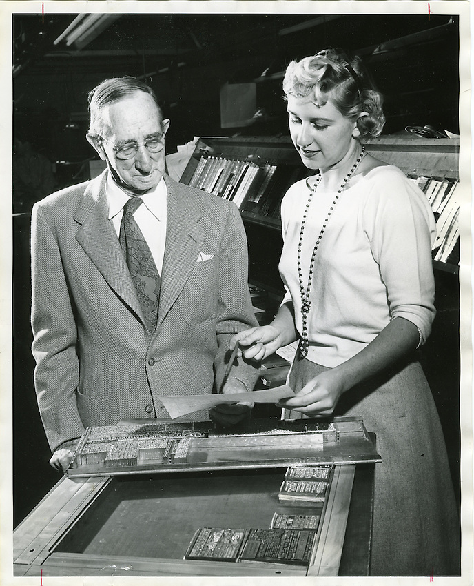 This is a Tucson Citizen file photo of George H. Smalley, former editor of the Tucson Citizen. He is seen here with his granddaughter, Dianne Moore, Citizen homes editor, in November, 1954.