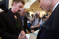 Vienna, Austria.<br /> T.C. Boyle (with red hair/beard) signing books.<br /> &ldquo;Eine Stadt, ein Buch (one city, one book)&rdquo; opening ceremony  at the Hauptb&uuml;cherei (main library), Urban-Loritz-Platz.<br /> As every year since 2002, the city of Vienna in cooperation with various sponsors gives away 100.000 free copies of a book by a world class author, this time &ldquo;Am&eacute;rica&rdquo; (The Tortilla Curtain) by American author T.C. Boyle.<br />More info at www.einestadteinbuch.at