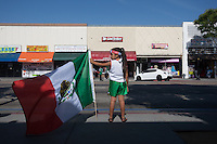 Los Angeles, CA -  Monday, June 23, 2014: A young Mexico fan celebrated Mexico's victory over Croatia on the streets of downtown  Huntington Park.