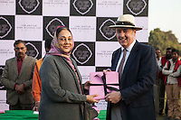 Her Highness Rajmata Padmini Devi of the Jaipur Royal family (left) receive a souvenir from Dr Lachlan Strahan of the Australian High Commission after the Argyle Pink Diamond Cup, organised as part of the 2013 Oz Fest in the Rajasthan Polo Club grounds in Jaipur, Rajasthan, India on 10th January 2013. Photo by Suzanne Lee