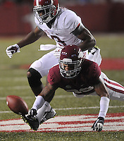 NWA Media/ J.T. Wampler -  Arkansas' Tevin Mitchel reaches for a pass intended for Alabama's Amari Cooper during the third quarter Saturday Oct. 11, 2014.