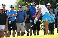 Lexi Thompson used her iron to get her bal back onto the 18th green at the 5th Annual Notah Begay III Foundation Challenge at Atunyote Golf Club in Vernon, New York on August 29, 2012