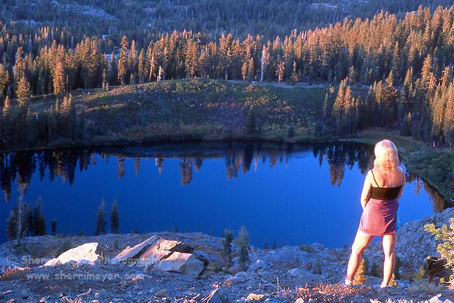 Hiker overlooking Island Lake from Grouse Ridge