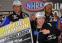Nov. 11, 2012; Pomona, CA, USA: NHRA top fuel dragster driver Antron Brown (right) celebrates with wife Billie Brown after winning the 2012 championship during the Auto Club Finals at at Auto Club Raceway at Pomona. Mandatory Credit: Mark J. Rebilas-