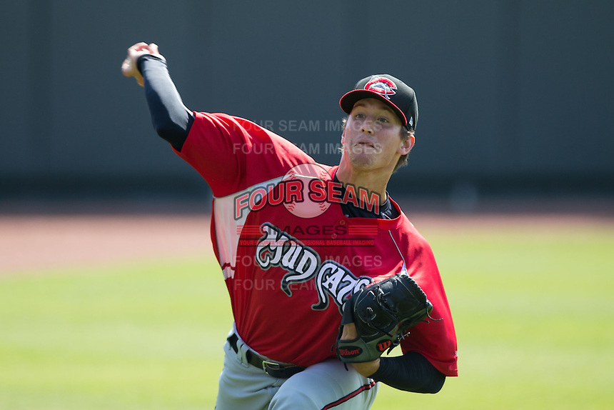 Carolina Mudcats starting pitcher Lucas Sims (27) warms up in the outfield prior to the game against the Winston-Salem Dash at BB&T Ballpark on April 22, 2015 in Winston-Salem, North Carolina.  The Dash defeated the Mudcats 4-2..  (Brian Westerholt/Four Seam Images)