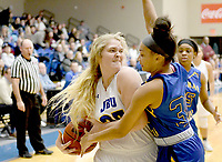 Bud Sullins/Special to the Herald-Leader<br /> John Brown freshman Kayla Nelson attempts to make a play last Thursday against Central Christian. Nelson and the Golden Eagles play at Science and Arts (Okla.) this Thursday in Sooner Athletic Conference action.