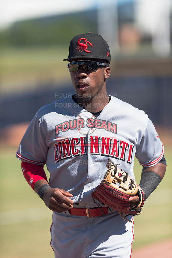 Scottsdale Scorpions second baseman Shed Long (6), of the Cincinnati Reds organization, jogs off the field between innings of an Arizona Fall League game against the Peoria Javelinas at Peoria Sports Complex on October 18, 2018 in Peoria, Arizona. Scottsdale defeated Peoria 8-0. (Zachary Lucy/Four Seam Images)