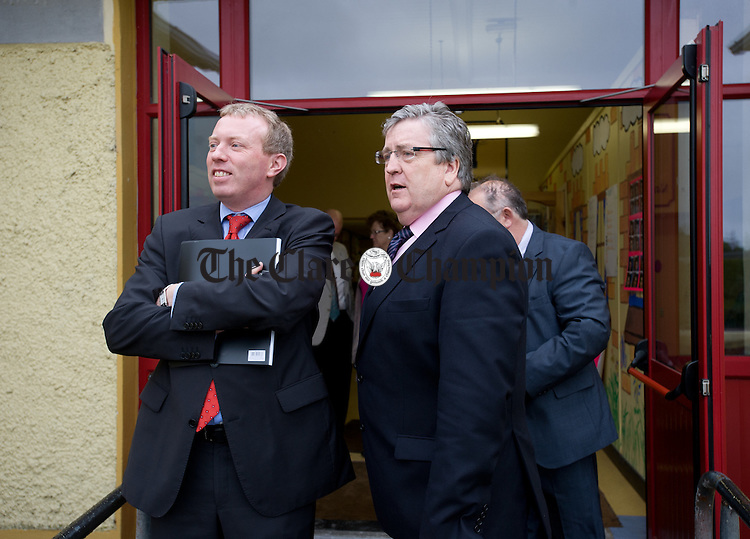 TDs Timmy Dooley and Pat Breen keeping an eye out for the arrival of Ruairi Quinn, TD, Minister for Education and Skills, to Sixmilebridge National School. Photograph by John Kelly.