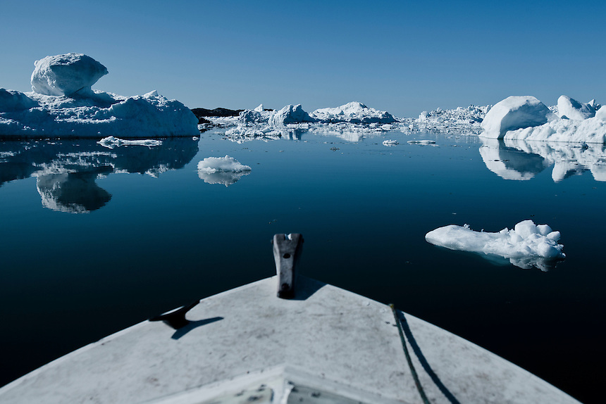 The bow of a small fishing boat moves through ice bergs off West Greenland, August 2011. Photo: Ed Giles.