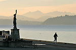 Seattle, Alki Point, West Seattle, Statue of Liberty, jogger, Puget Sound, Olympic Mountains, Pacific Northwest, Washington State, United States,
