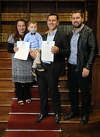 Young Ibrahim Husejni (2nd L) with his father Raman Husejni (3rd L) his mother (L) and a family friend at the Citizenship Ceremony at Carmarthen Register Office, Carmarthenshire, Wales, UK. Monday 22 August 2016