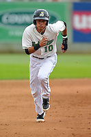 Luis Caballero #10 of the Clinton LumberKings runs to third base against the Kane County Cougars at Ashford University Field on July 5, 2014 in Clinton, Iowa. The Cougars won 4-0.   (Dennis Hubbard/Four Seam Images)
