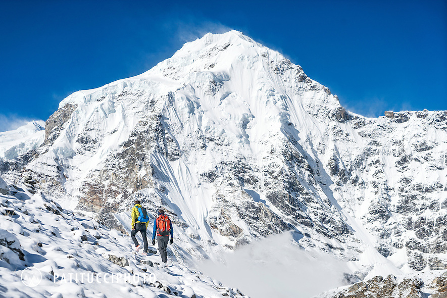 Ueli Steck and David Göttler hiking out of basecamp in fresh snow after their 2016 Shishapangma climbing expedition, Tibet
