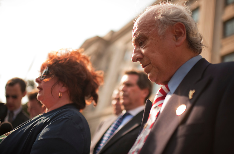 UNITED STATES - AUGUST 24:  Maureen and Al Santora, foreground, who lost their firefighter son Christopher, attend a news conference with 9/11 families outside of the Justice Department after a meeting between the families and Attorney General Eric Holder.  The meeting was about News Corp's alleged hacking of the phones used by 9/11 victims and their families and Holder told them that Justice department would pursue a preliminary criminal investigation on the matter.  (Photo By Tom Williams/Roll Call)