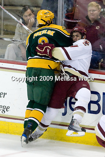 Nik Pokulok (Clarkson - 2), Tommy Cross (BC - 4) - The Boston College Eagles defeated the Clarkson University Golden Knights 6-5 on Friday, November 27, 2009, at Conte Forum in Chestnut Hill, Massachusetts.