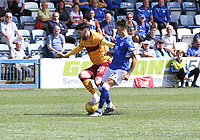 Connor Murray tackling Liam Donnelly in the SPFL Betfred League Cup group match between Queen of the South and Motherwell at Palmerston Park, Dumfries on 13.7.19.
