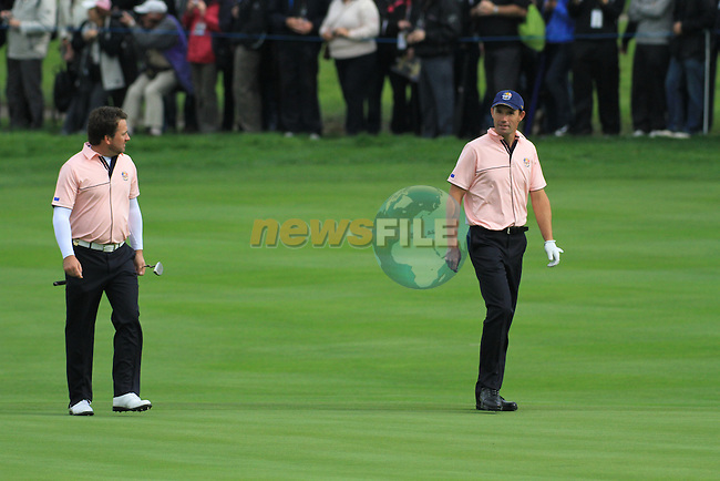 2010 Ryder Cup at the Celtic Manor twenty ten course, Newport Wales, 30/9/2010 Practice Day 3..Graeme McDowell and Padraig Harrington walk the 13th fairway..Picture Fran Caffrey/www.golffile.ie.