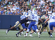 Annapolis, MD - October 7, 2017: Air Force Falcons quarterback Arion Worthman (2) gets hits while passing the ball during the game between Air Force and Navy at  Navy-Marine Corps Memorial Stadium in Annapolis, MD.   (Photo by Elliott Brown/Media Images International)
