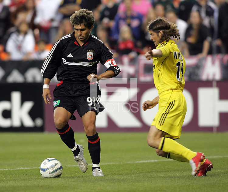 7 May 2005.  DC United's Jaime Moreno (9) tries to keep the ball away from Columbus' Chris Wingert (19) at RFK Stadium in Washington, DC.
