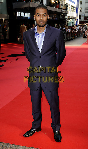 "NOEL CLARKE.Arrivals at the UK Premiere of the new Batman movie ""The Dark Knight"", Odeon Leicester Square, London, England, .July 21st 2008. .full length purple suit shirt beard stubble.CAP/CAN.©Can Nguyen/Capital Pictures"