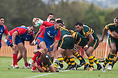 Paul Ivamy goes for the ankles as Fritz Lee charges from the back of scrum. Counties Manukau Premier Club Rugby game between Ardmore Marist and Pukekohe played at Bruce Pulman Park on Saturday April 17th..Pukekohe won the game 25 - 0 after leading 15 - 0 at halftime.