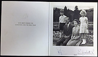 BNPS.co.uk (01202 558833)<br /> Pic: Rowleys/BNPS<br /> <br /> Pictured: 1955 - Back to Balmoral with Charles and Anne sold for £170<br /> <br /> A series of Christmas cards sent by the Royal Family to a married couple on their staff over a 25 year period have sold for £2,000.<br /> <br /> Most of the cards were sent by the Queen and Prince Philip and show the changing face of the monarchy from the black-and-white post war world to the colourful 1970s.<br /> <br /> They were sent to the couple who worked at Balmoral, the wife in the house and the husband on the estate.<br /> <br /> The cards were sold individually with the most expensive being the one for Christmas 1947 which was signed by King George VI and the Queen Mother.