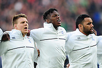 Paul Hill, Maro Itoje and Billy Vunipola of England sing the national anthem. RBS Six Nations match between England and Ireland on February 27, 2016 at Twickenham Stadium in London, England. Photo by: Patrick Khachfe / Onside Images