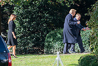 United States President Donald J. Trump and US Senator Lindsey Graham (Republican of South Carolina), followed by First lady Melania Trump, left, are in discussion on the South Lawn of the White House in Washington, DC after their return from the Supreme Court of the US on Thursday, November 8, 2018.<br /> Credit: Ron Sachs / Pool via CNP /MediaPunch