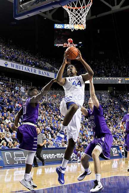 Sophomore center Dakari Johnson gets fouled while shooting the ball in the key during the first half of the University of Kentucky vs. Grand Canyon University men's basketball game at Rupp Arena in Lexington, Ky., on Friday, November 14, 2014 Photo by Jonathan Krueger | Staff