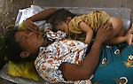 Cyclone Nargis survivors sleep at a temple turned into a makeshift refugee center in the town of Labutta, in Irrawaddy Division, May 10, 2008. Despairing survivors in Myanmar awaited emergency relief on Friday, a week after 100,000 people were feared killed as the cyclone roared across the farms and villages of the low-lying Irrawaddy delta region. The storm is the most devastating one to hit Asia since 1991, when 143,000 people were killed in neighboring Bangladesh. Photo by Eyal Warshavsky  *** Local Caption *** ëì äæëåéåú ùîåøåú ìàéì åøùáñ÷é àéï ìòùåú áúîåðåú ùéîåù ììà àéùåø