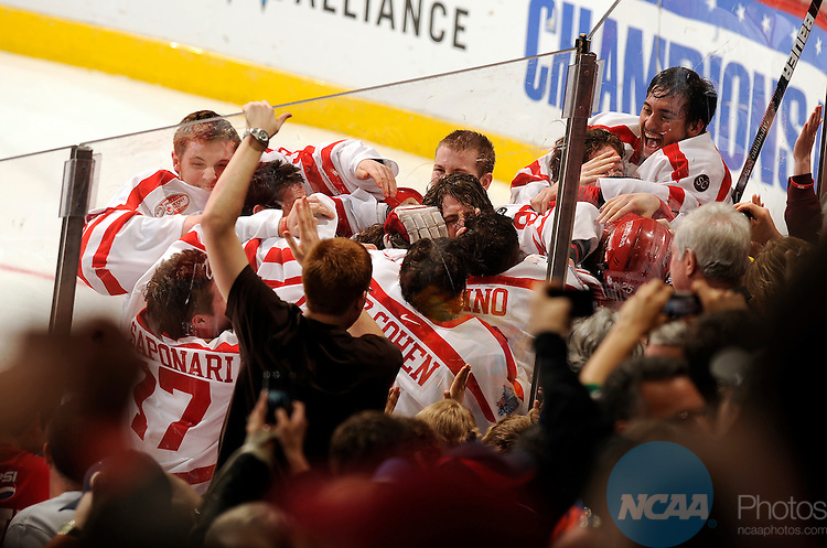 11 APR 2009:  Boston University celebrates after a victory over Miami (OH) University during the Division I Men's Ice Hockey Championship held at the Verizon Center in Washington, DC.  Boston University defeated Miami (OH) University 4-3 in overtime to win the national title.  Greg Fiume/NCAA Photos