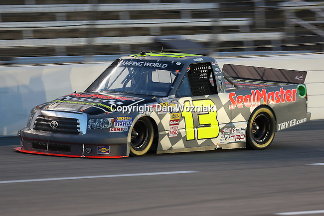 Camping World Truck Series driver Todd Bodine (13) in action during the NCWTS Winstar World Casino 400 race at Texas Motor Speedway in Fort Worth,Texas.