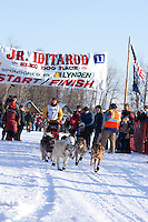 Annika Oleson leaves the start line of the Junior Iditarod  at Knik Lake, Knik, Alaska