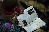 A woman looks at the collection book while people attend Doyle's Books, Autographs and Maps auction of important Frida Kahlo archive in New York.  04/15/2015