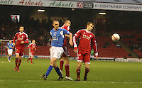 Andrew Considine (centre) and Mark Reynolds (right) watch the ball going back under pressure from Tom Brighton in the Aberdeen v Queen of the South William Hill Scottish Cup 5th Round match played at Pittodrie Stadium, Aberdeen on 4.2.12.