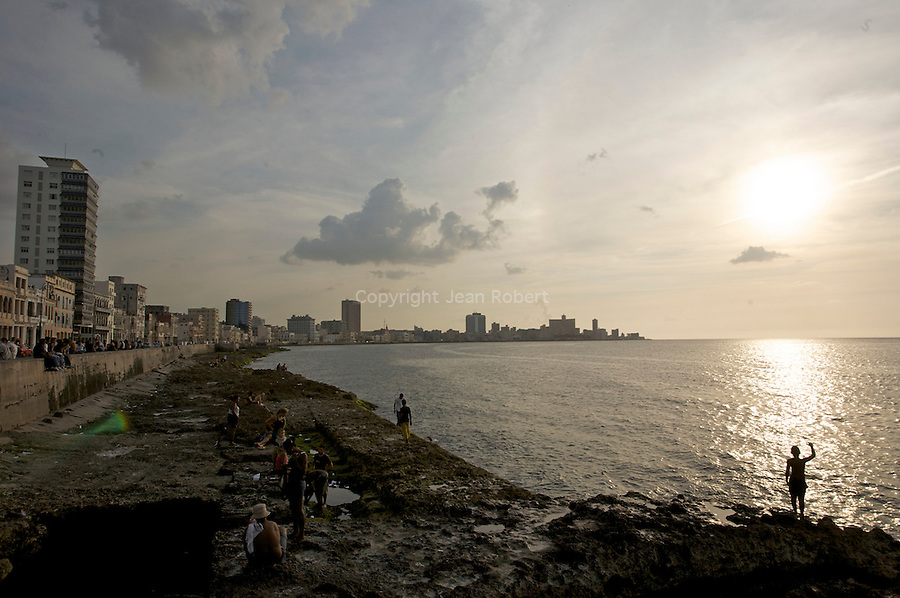 The Malecón is a broad esplanade, roadway and seawall which stretches for 8 km along the coast in Havana. built  in 1901, during temporary U.S. military rule, it's the meeting point for all cubans for the sunset time.