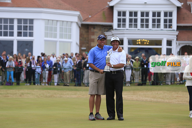 Phil MICKELSON (USA) seen here with his caddie John (bones) Mackay is the champion golfer at the 142th Open Championship Muirfield, Gullane, East Lothian, Scotland 21/7/2013<br /> Picture Fran Caffrey www.golffile.ie: