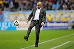 Nederland , Arnhem , 29 maart 2014<br /> Eredivisie<br /> seizoen 2013-2014<br /> Vitesse - Heerenveen<br /> Vitesse Coach Peter Bosz schiet de bal weg