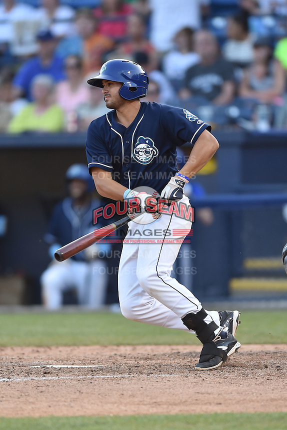 Asheville Tourists first baseman Josh Fuentes (21) swings at a pitch during a game against the Charleston RiverDogs on June 13, 2015 in Asheville, North Carolina. The Tourists defeated the RiverDogs 10-6. (Tony Farlow/Four Seam Images)