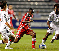 Chicago Fire midfielder Thiago (10) dribbles between DC United defender Facundo Erpen (5, left) and midfielder Clyde Simms (19, right).  The Chicago Fire defeated the DC United 3-0 in the semifinals of the U.S. Open Cup at Toyota Park in Bridgeview, IL on September 6, 2006...