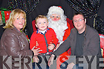 WELCOME; Santa welcomed to his christmas grotta at the Ardfert Community Centre on Friday evening l-r: Martha Leen, Dylan and John McCoy (Ardfert).