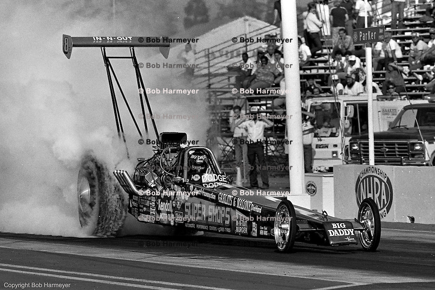 "POMONA, CALIFORNIA: ""Big Daddy"" Don Garlits drives his Top Fuel dragster during a 1985 NHRA drag race at Pomona, California."