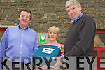 LIFE SAVER: Paddy Keane, Nora Gaire and Fr Pat Moore with the new community defibrillator which is located at the rear of St Brigid's Church in Duagh.