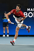 11th January 2020; Sydney Olympic Park Tennis Centre, Sydney, New South Wales, Australia; ATP Cup Australia, Sydney, Day 9; Serbia versus Russia;  Novak Djokovic versus Daniil Medvedev; Novak Djokovic of Serbia follows throw on serve to Daniil Medvedev of Russia - Editorial Use