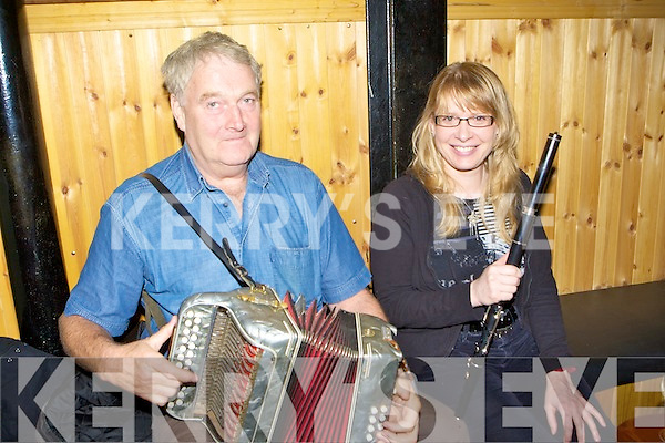Brendan Sullivan and Eileen de Paor entertaining the crowd in Hartnett's bar during the Padraig O'Keeffe festival in Castleisland on Monday .